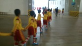 A group of young match mascots prepare to take to pitch and meet the players in Brasilia. Source: Alec Herron